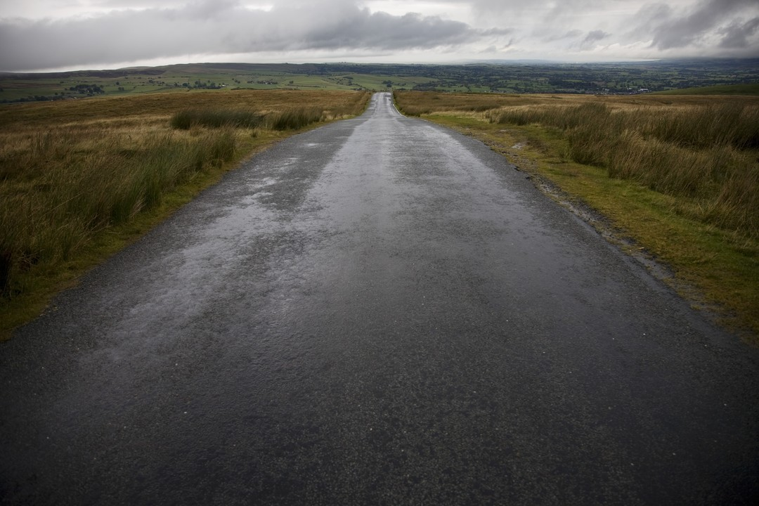 Wet road in Yorkshire Dales, Yorkshire, England